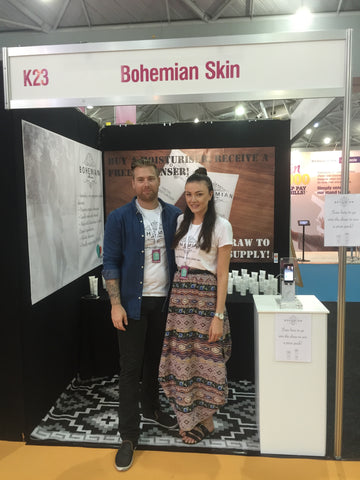 Image of Bohemian Skin Expo stand with the founders at the front.