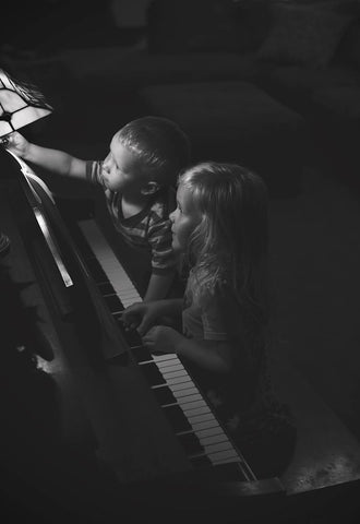 twins playing piano