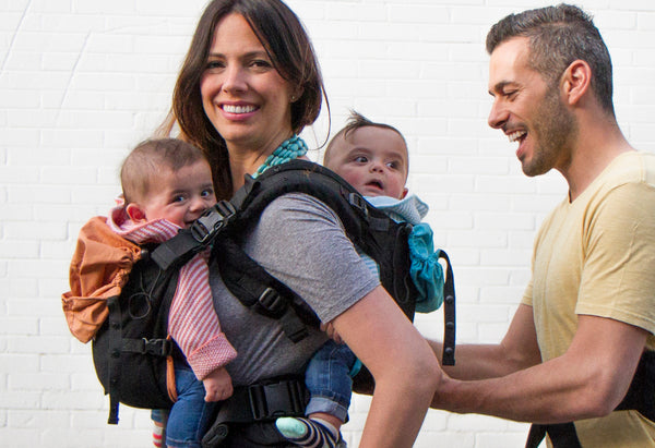 Father Helping Mother Babywearing Twins in the TwinGo Carrier