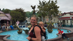 twin mom at disney with twins in twingo carrier