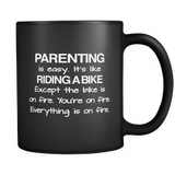 Parenting Is Easy Black Mug
