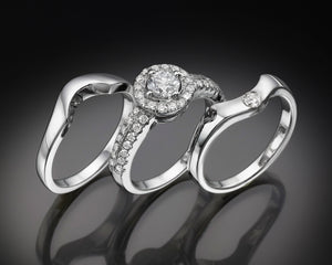 """Eimy""- French-Set Halo Solitaire Diamond Band."