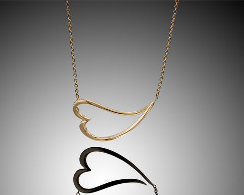 Devotion Heart shaped necklace,18k yellow gold | Layanijewelry.com,heart shape