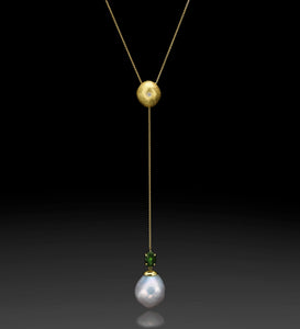 """Green Flame""- Yellow gold lariat pendant set with Tourmaline."