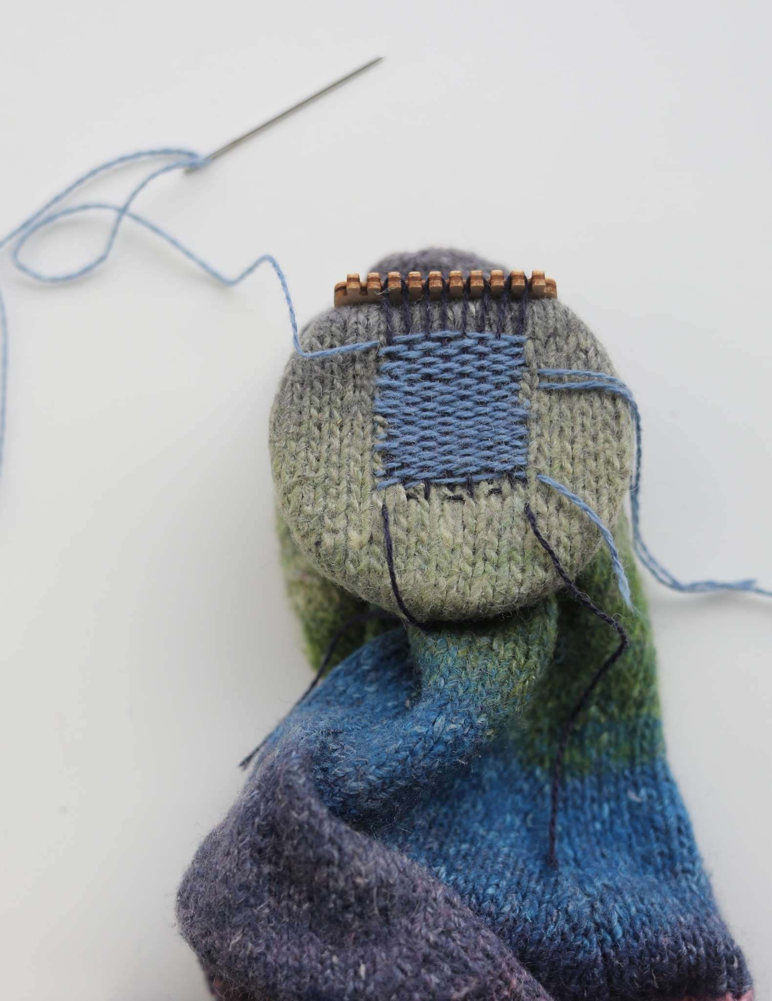 The entire hole has now been covered by both vertical and horizontal strands, creating a dense fabric to cover the hole of the sock.