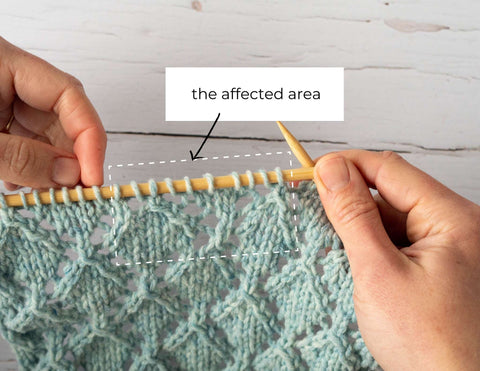 photo showing the affected area of knitting