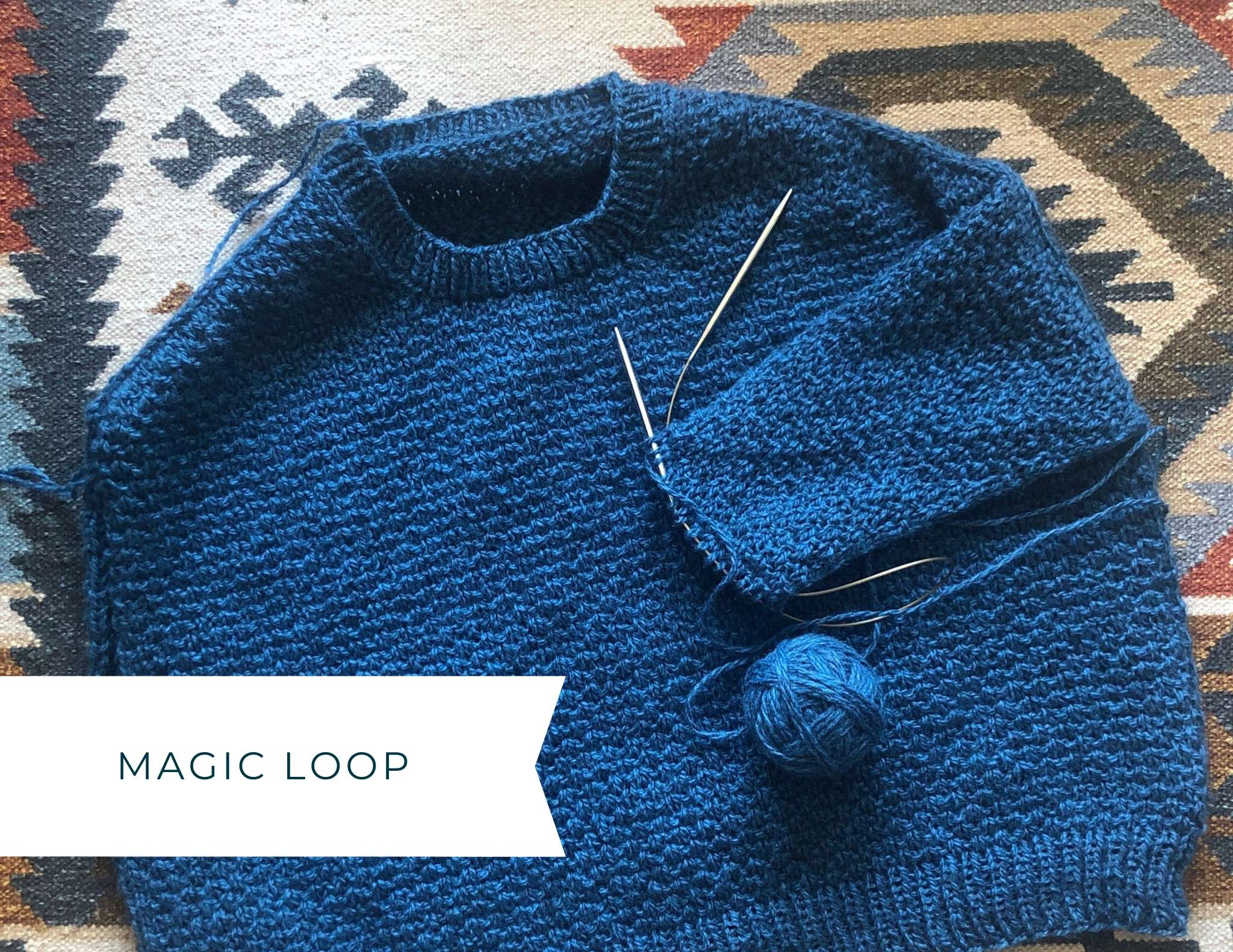 Photo showing a blue glenmore with the sleeve in progress on one long circular needle with a loop of the cable pulled out. The image has a text overlay saying magic loop.