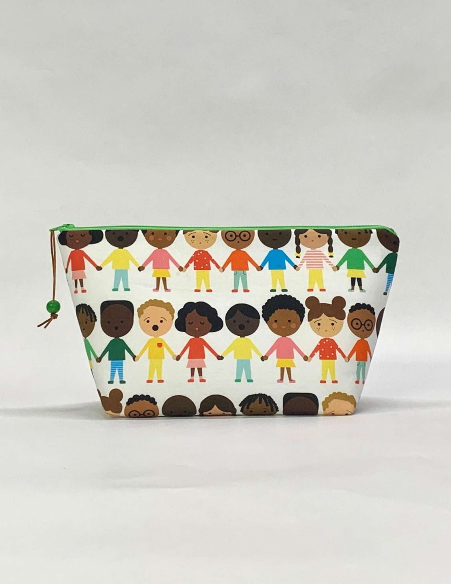 A project bag with zip made in a fabric showing drawings of people of different skin colours holding hands
