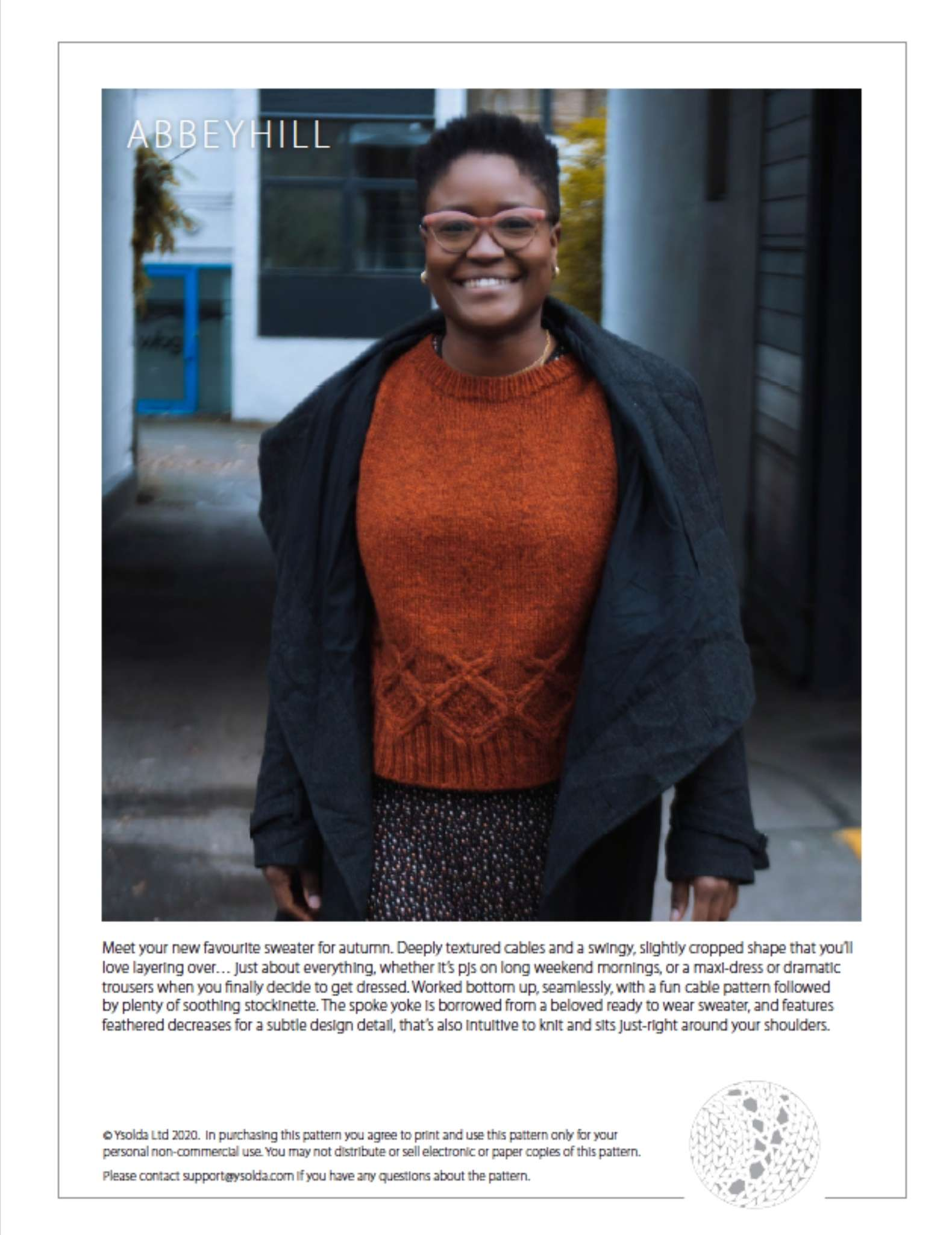 cover page of a pattern showing a black woman wearing an orange sweater, walking towards the camera. She wears a dark jacket that is open at the front and is smiling. Text describing the sweater design is shown underneath.