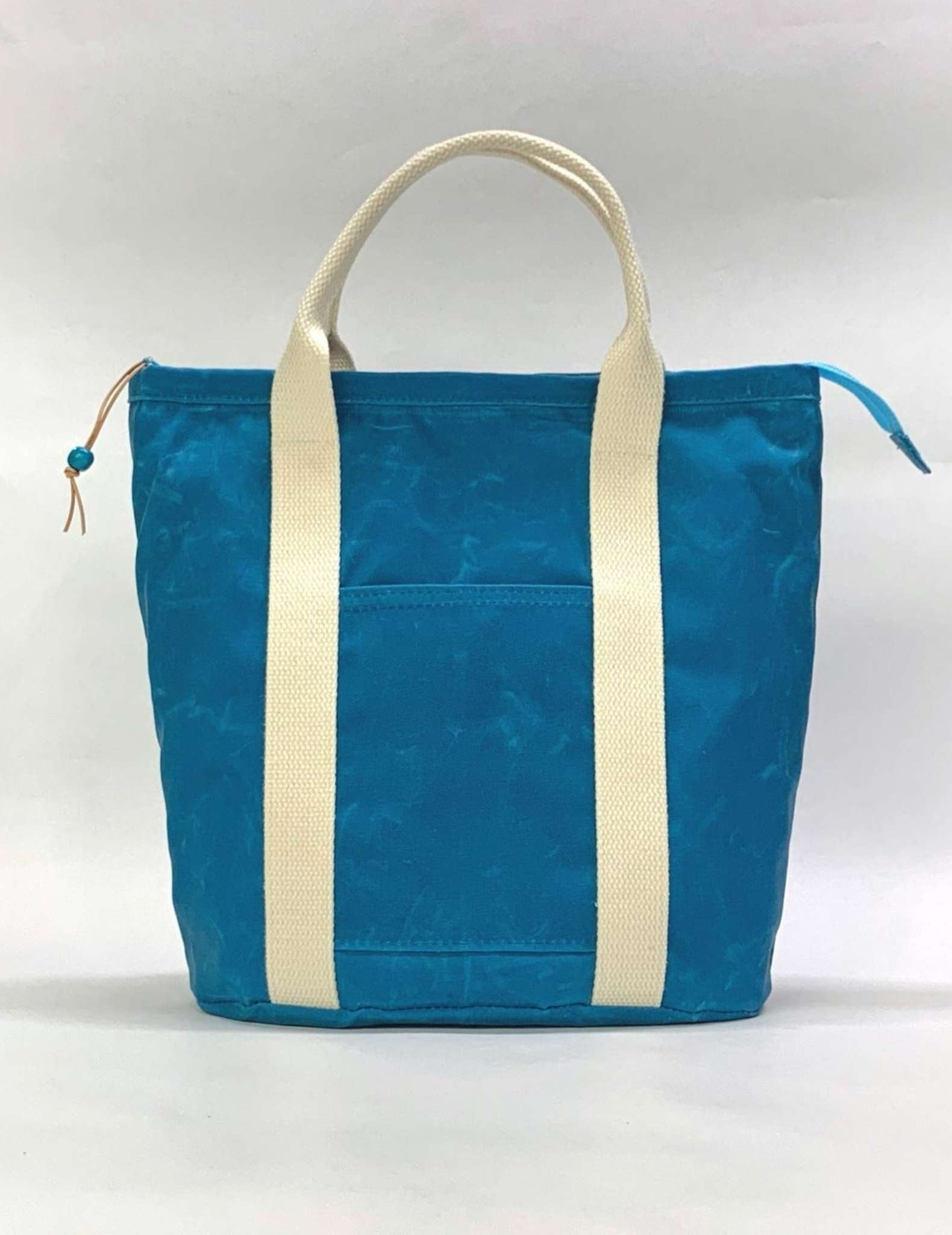 A blue and white waxed canvas knitting bag