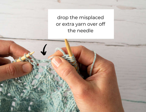 """Photo showing the stitch above the yarn over unravelling with the text: drop the misplaced or extra yarn over off the needle"""""""