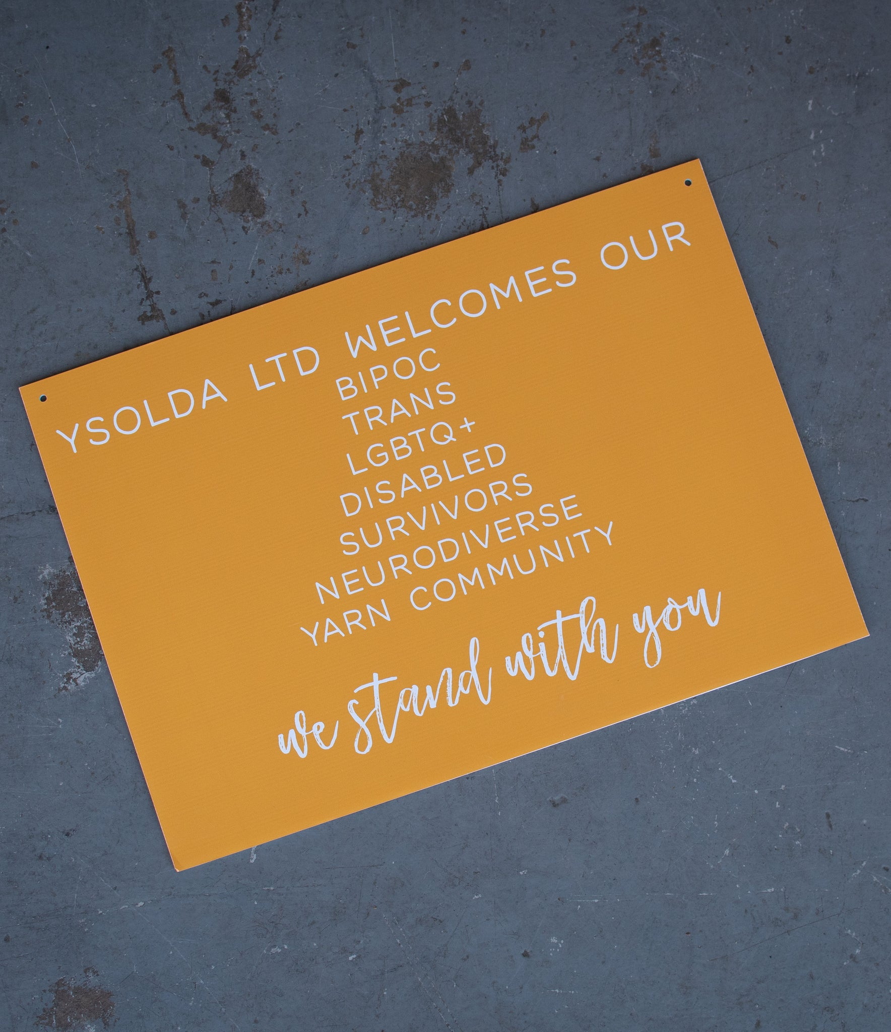 Image of a sign that reads 'Ysolda Ltd welcomes our BIPOC, Trans, LGBTQ+, Disabled, Survivors, Neurodiverse Yarn Community. We Stand With You.