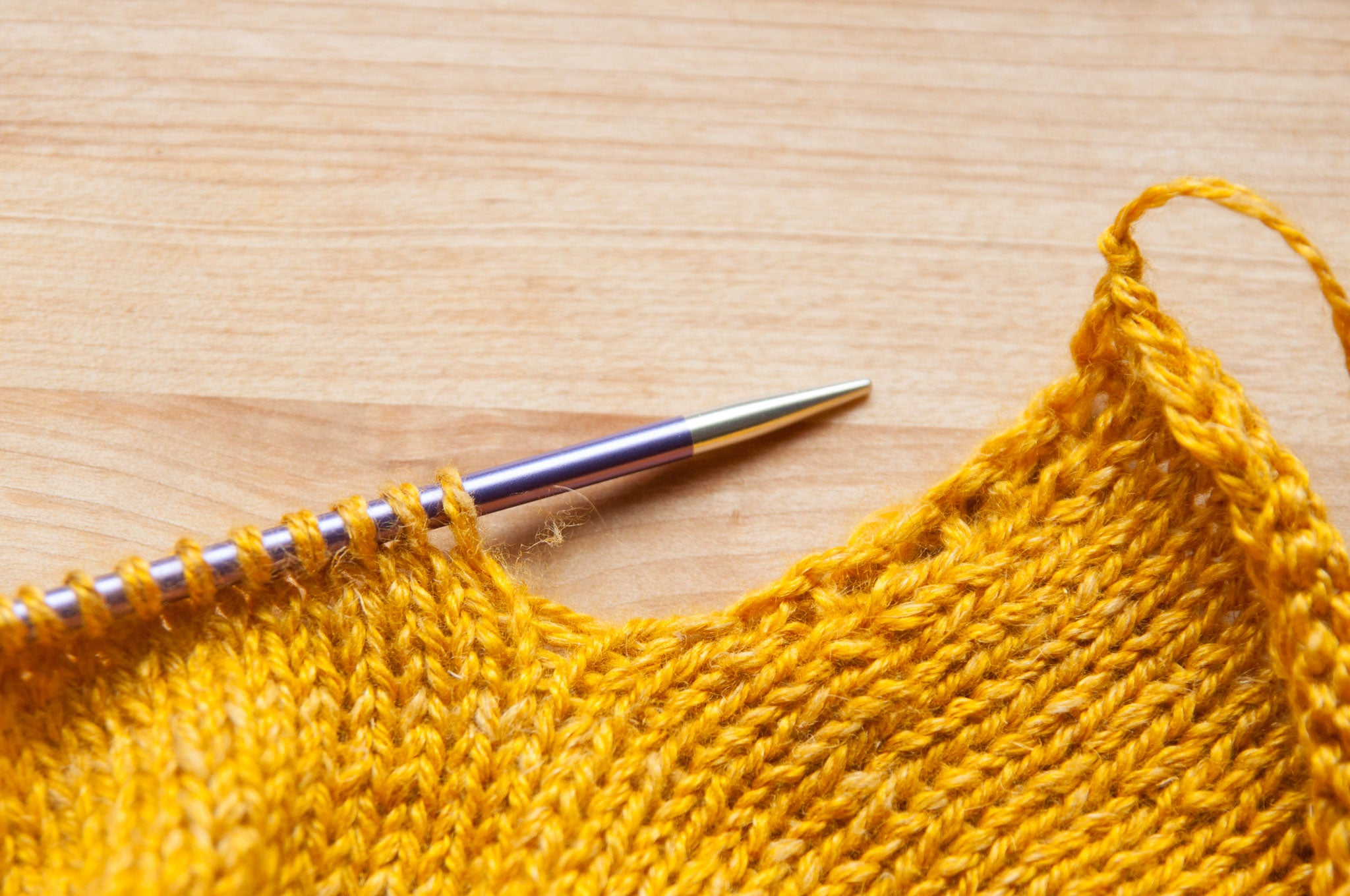 Return the back hem stitches to the needles.