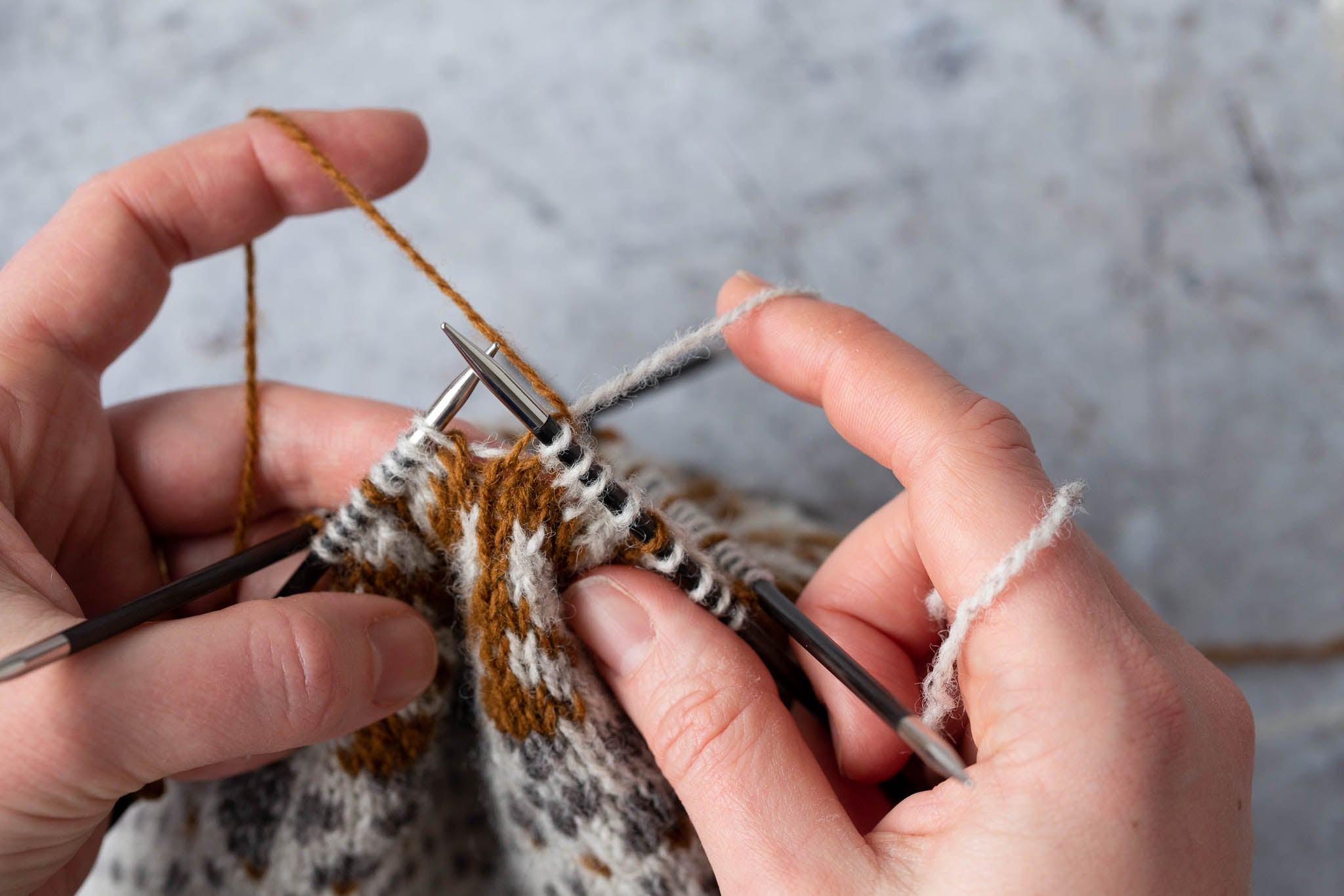 The yarn is now trapped in the back of the stitch. Continue in your working yarn.