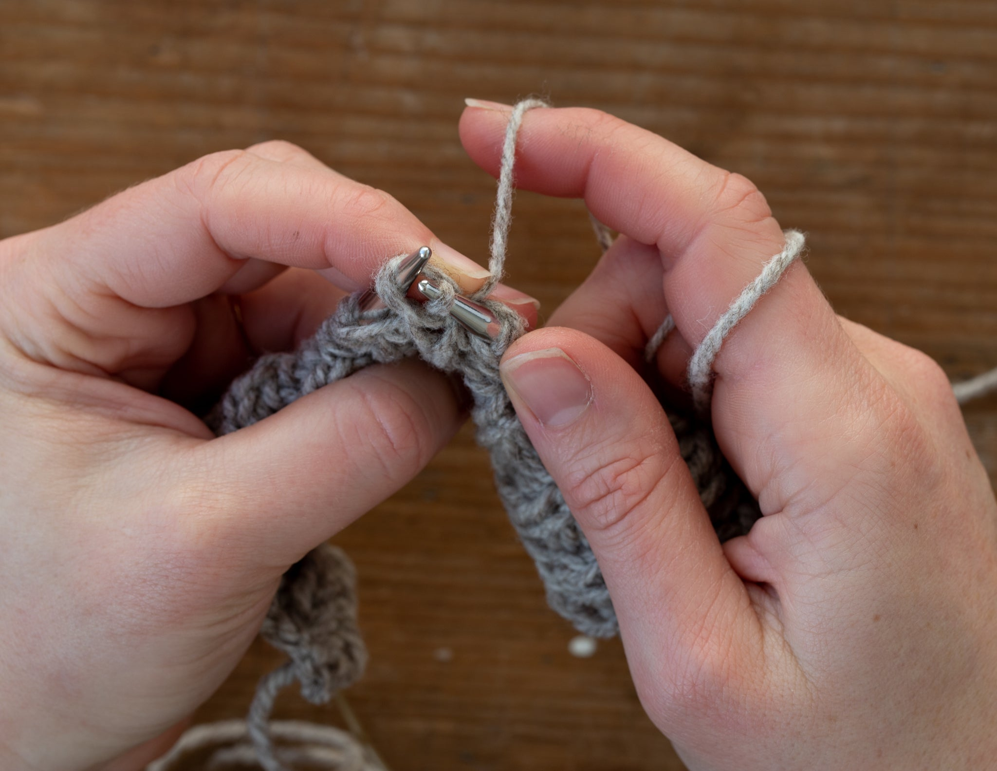 Knit the next stitch and pass the slipped stitch over it and off the needle.