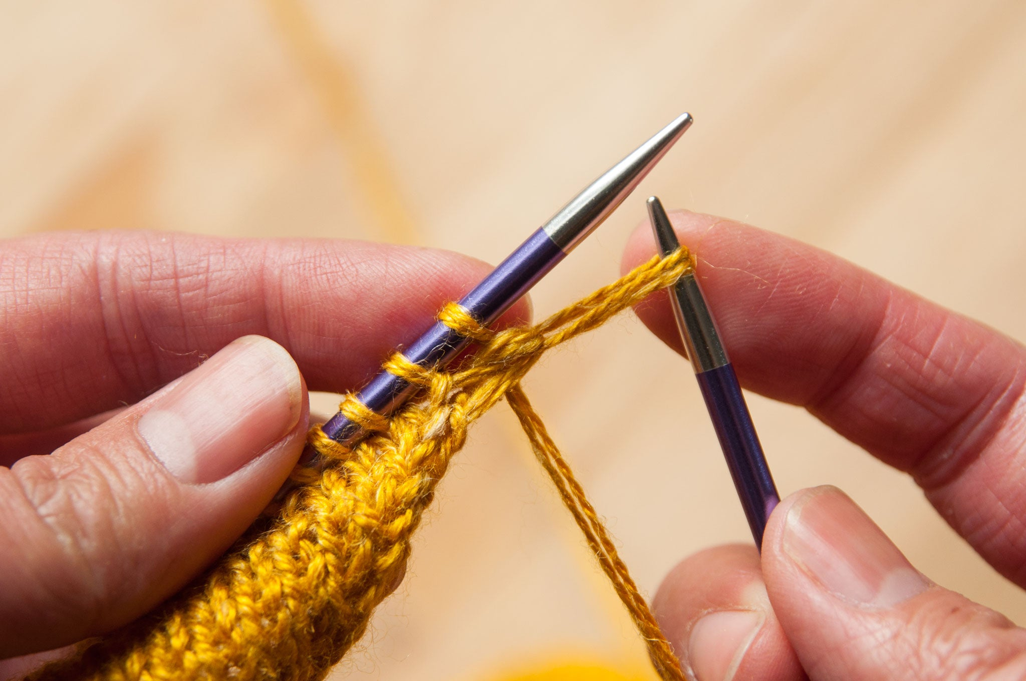 Elongate this stitch by pulling it towards you.