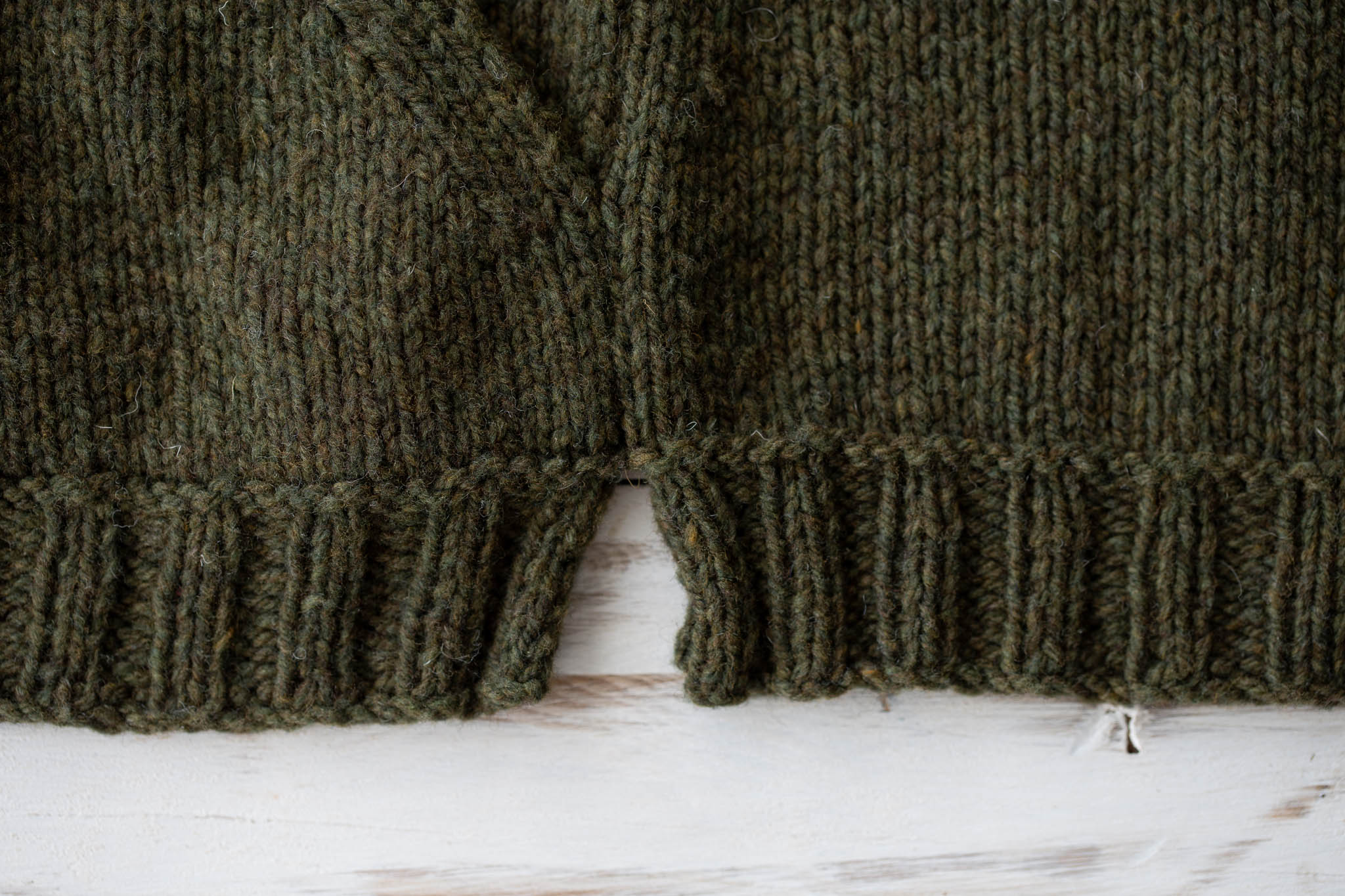 Use mattress stitch to seam the sleeve and side, leaving the ribbing open at the bottom for side slits.
