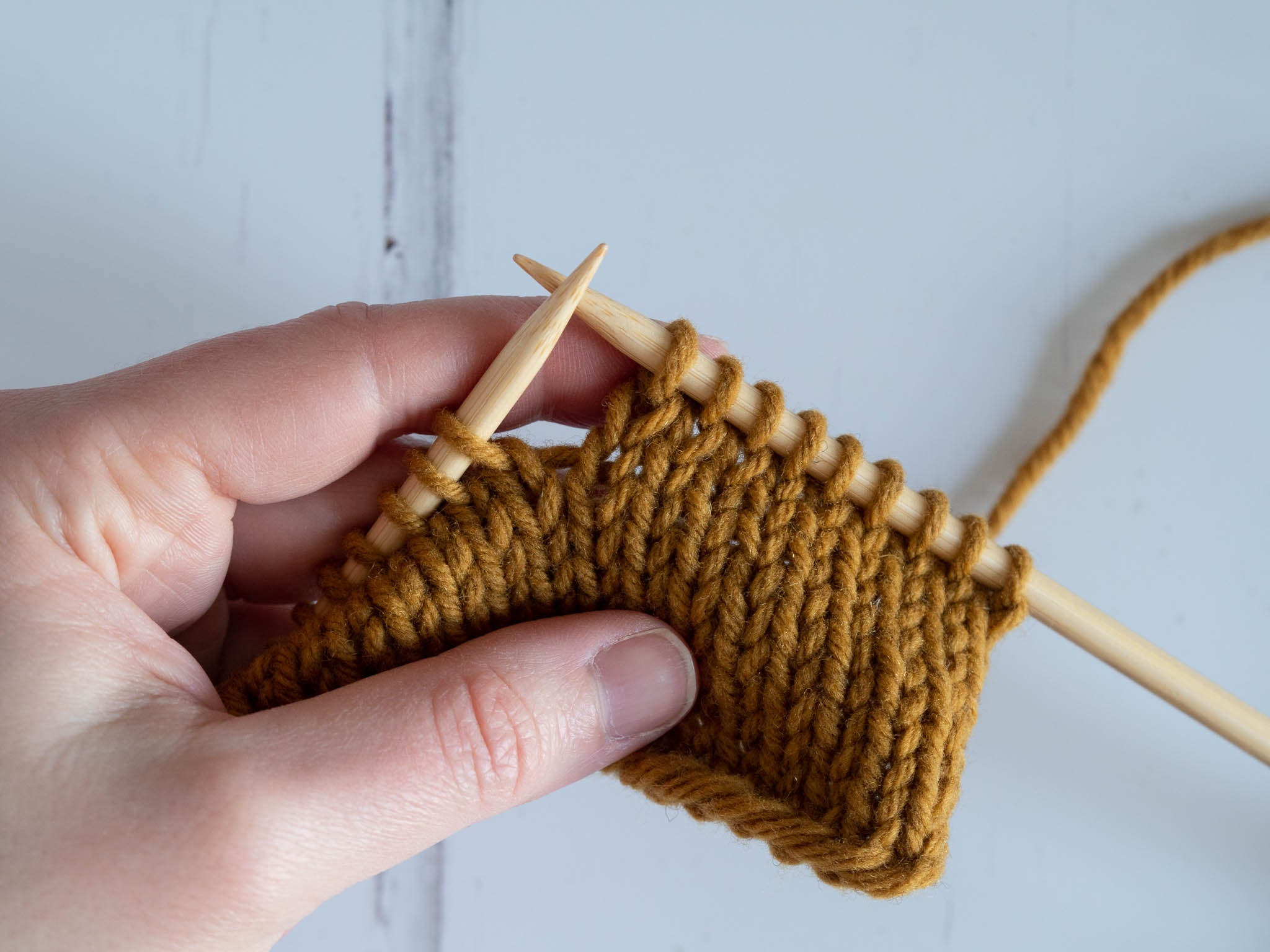 completed knit stitches on right needle