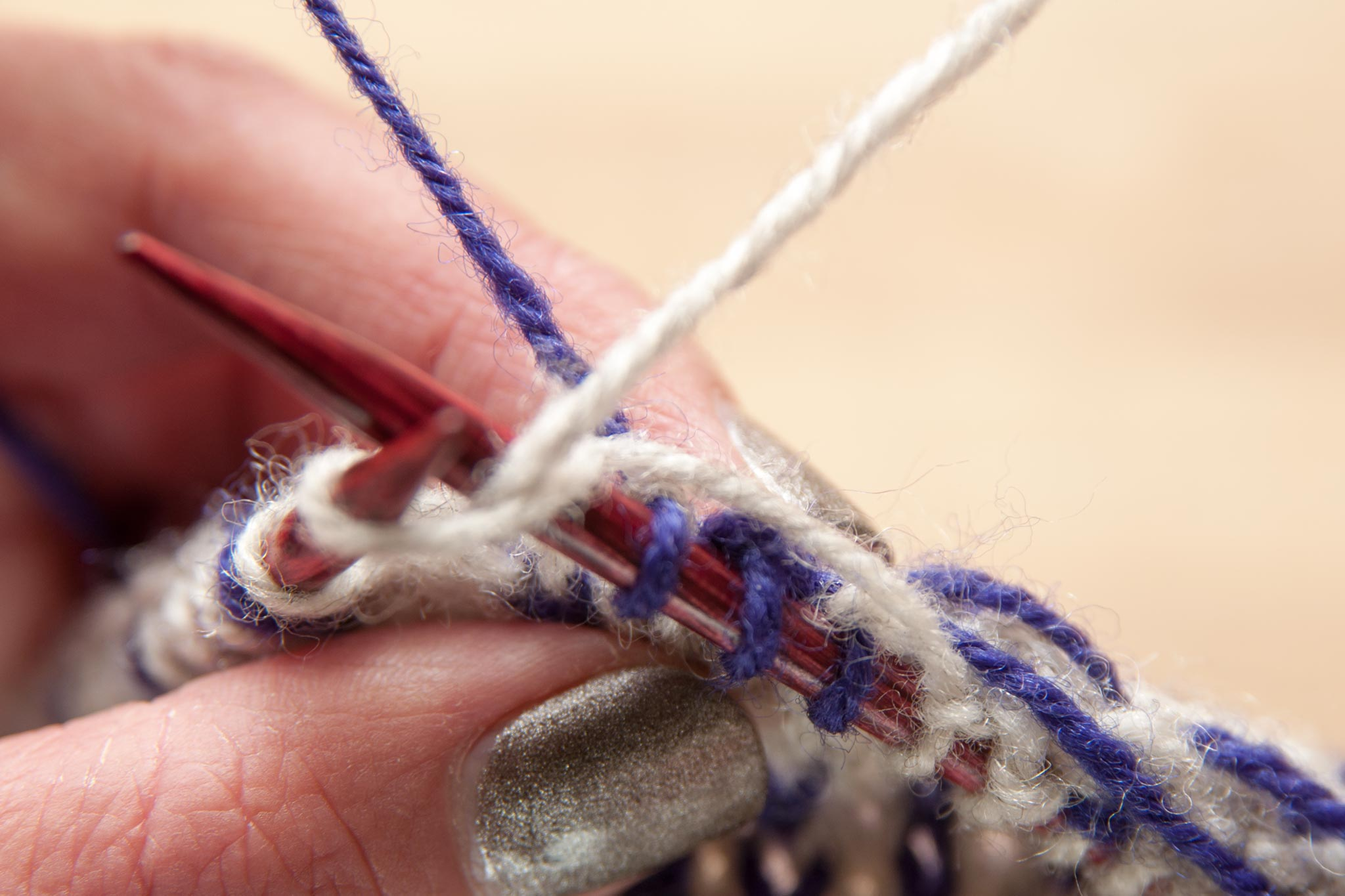 Spread out the stitches on the right needle before working the next stitch.