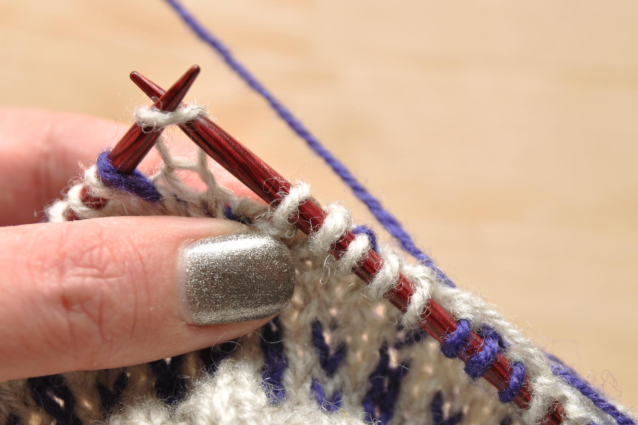 Spread out stitches on the right needle to prevent tight floats.
