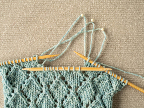 photo showing the section mostly re-knit with 3 rows left to do