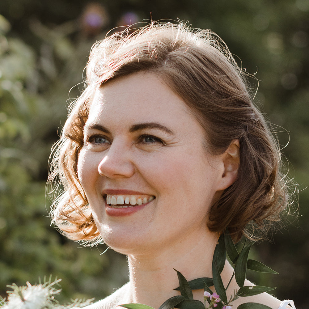 Image of white woman smiling at a wedding