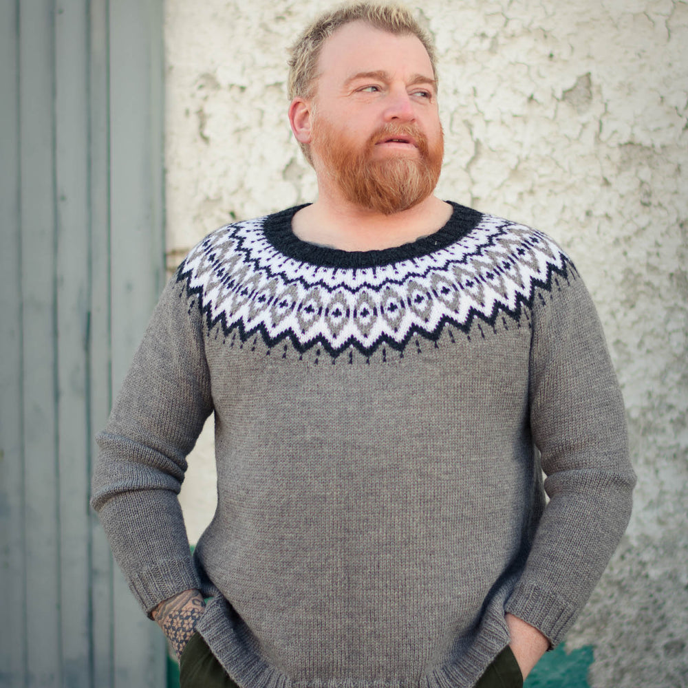 Ginger man wearing the Brunstane sweater in the monochrome palette.