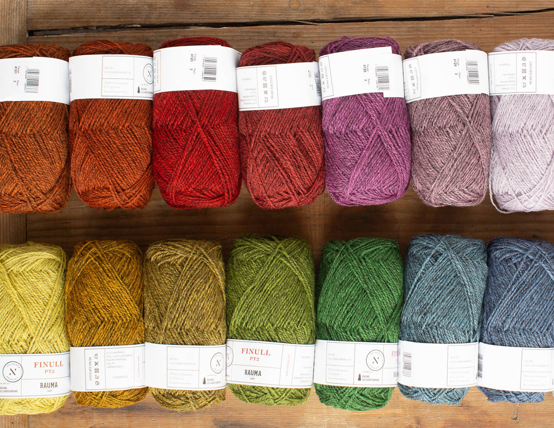 a line up of shades of heathered yarn