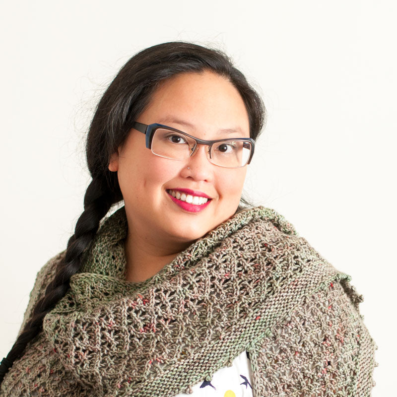 A Chinese-Canadian woman with glasses smiling at the camera.