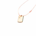 18 Karat Amber Hue Gold Baby Dog Tag with Solitaire Diamond - Chris Aire Fine Jewelry & Timepieces