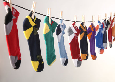 Performance Merino wool socks hanging from line