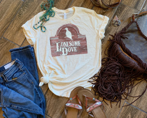 Cream tee red lonesome dove sign