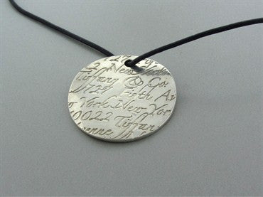thumbnail image of Tiffany & Co Notes Collection Sterling Silver Leather Cord Necklace
