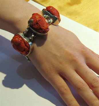 thumbnail image of Chunky Stephen Dweck One of a Kind Carved Coral Fish Sterling Bracelet