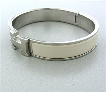 thumbnail image of Estate Hermes Silver Tone Metal White Enamel Letter H Bangle Bracelet