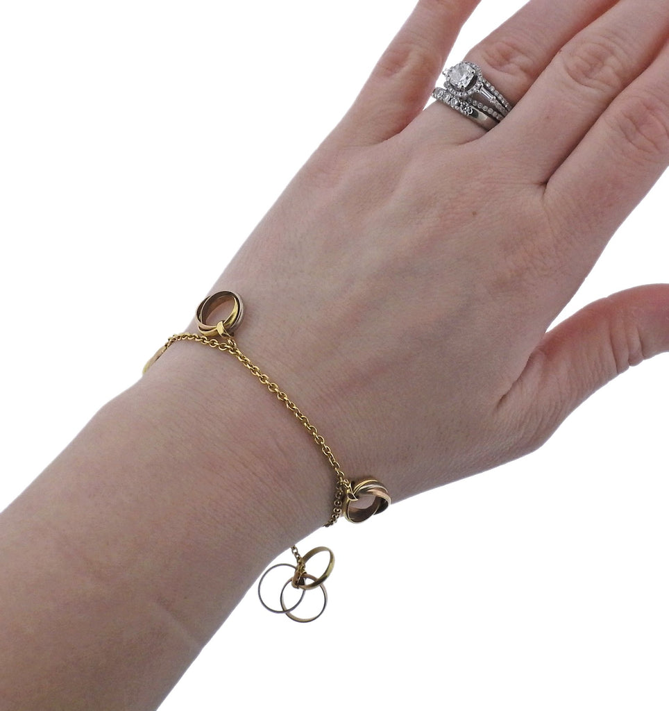 thumbnail image of Cartier Trinity Gold Charm Bracelet