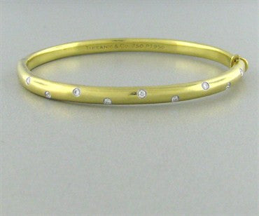 thumbnail image of Tiffany & Co 18K Gold Platinum Etoile Diamond Bangle Bracelet
