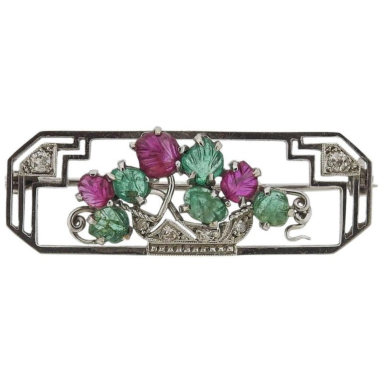 thumbnail image of Art Deco Carved Emerald Ruby Diamond Platinum Brooch