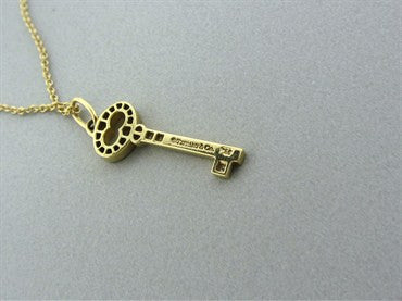 thumbnail image of Tiffany & Co Keys Vintage Oval Key 18K Gold Diamond Pendant Necklace