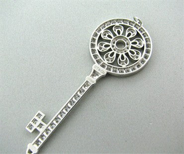 image of Tiffany & Co Petals Platinum 1.18ctw Diamond Key Pendant