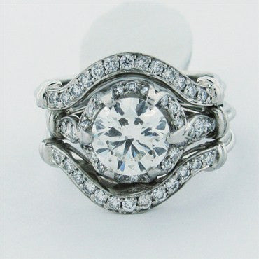 thumbnail image of Estate Peter Norman EGL Certified 1.38ct Diamond Platinum Rings