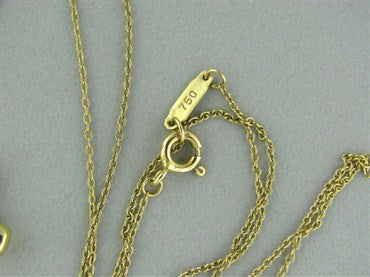 image of Tiffany & Co 18K Gold Platinum Etoile Diamond Cross Pendant Necklace