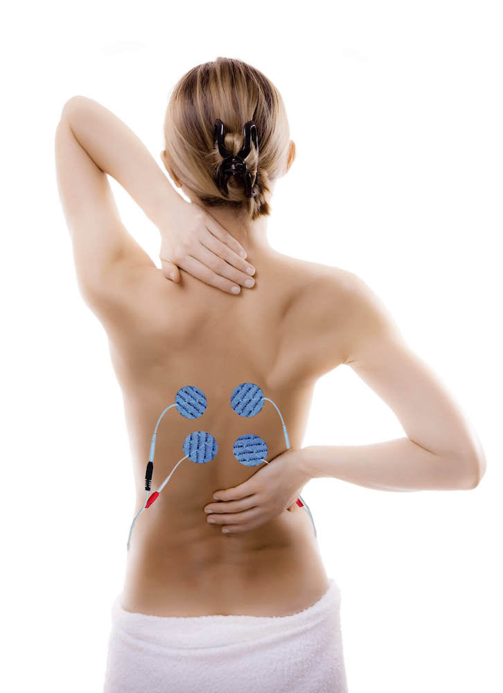 woman's back with electronic muscle stimulator devices attached - Tone-A-Matic Electronic Muscle Stimulators in Canada
