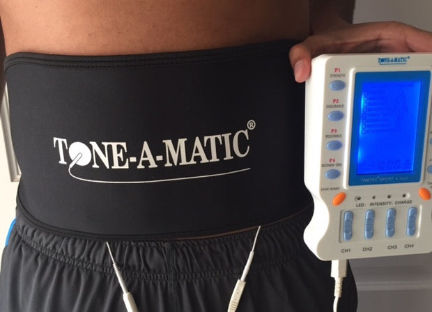 Man wearing Tone-A-Matic Abdominal Belt that is connected to the TAMTEC SPORT 4 PLUS machine
