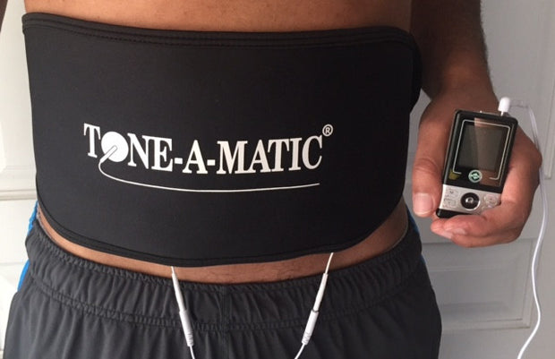 Man wearing Tone-A-Matic Abdomina/Back Belt that is connected to a TENS massager