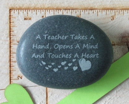 Quote- A teacher takes a hand...