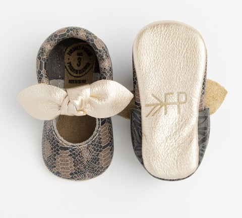 Freshly Picked Platinum Snakeskin Knotted Bow Soft Sole Moccasins