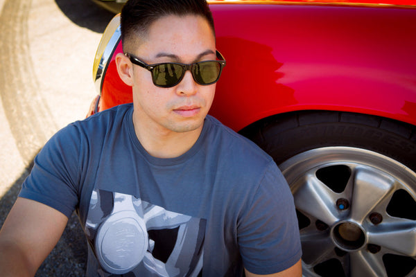 RetroGrade Fuchs T-Shirt on Model Next to Red Porsche