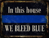 """IN THIS HOUSE WE BLEED BLUE"" - NOVELTY METAL PARKING SIGN"