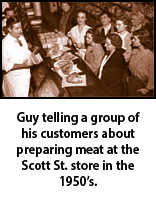Guy Dickens telling a group of his customers about preparing meat at the Scott St. store in the 1950s.